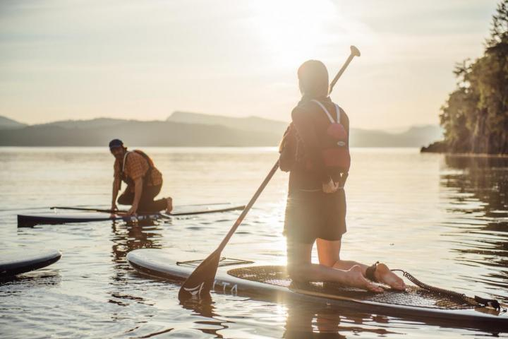Pender Island Kayak Adventures SUP on the water in the sunset
